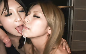 Twosome horny Japanese babes show a horny businessman the sights
