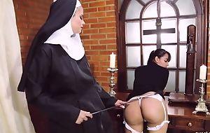 Defamatory nun fucks her girlfriend with strapon dildo